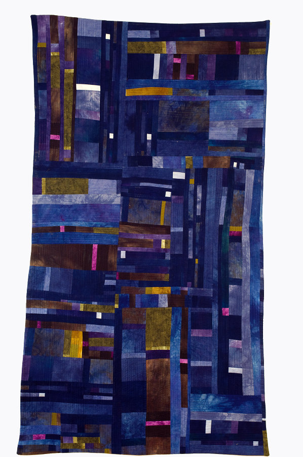 modern pieced quilt with hand-dyed material